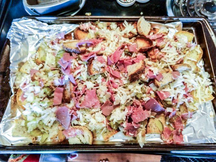 Reuben nachos ready to be cooked